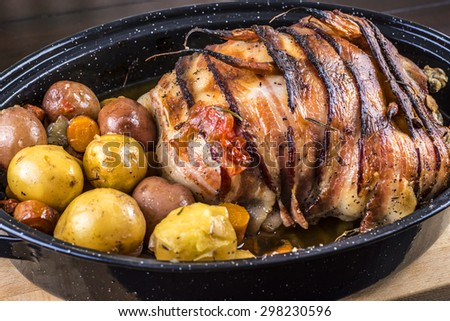 Bacon wrapped roasted chicken stuffed with butternut squash and herbs - stock photo