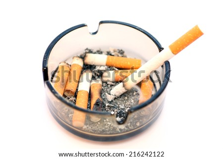 Bad addiction. Ashtray and cigarettes closeup. - stock photo