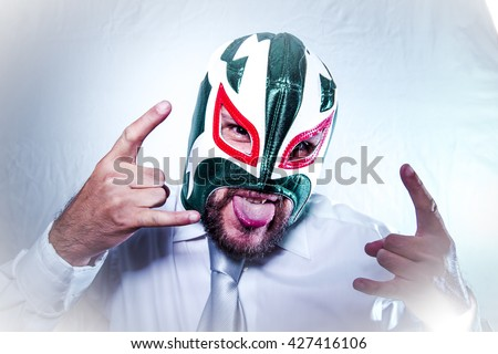 Bad, angry businessman with Mexican wrestler mask, expressions of anger and rage - stock photo