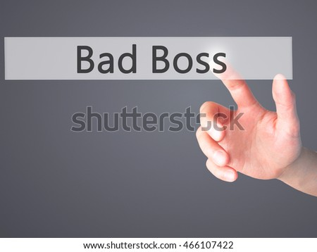 Bad Boss - Hand pressing a button on blurred background concept . Business, technology, internet concept. Stock Photo