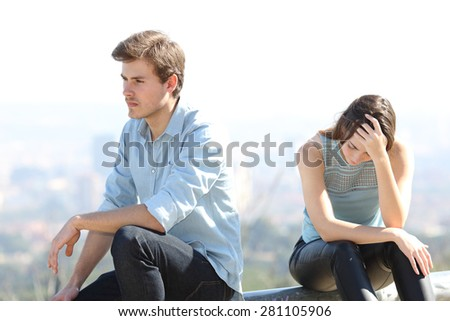 Bad boy arguing with his couple breakup concept with the city in the background - stock photo
