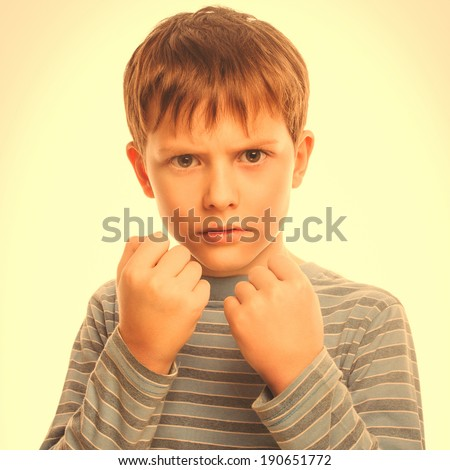 bad bully child boy blond angry aggressive fights in striped shirt isolated studio on white background large cross processing retro - stock photo