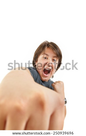 bad bully chubby child kid or boy angry and aggressive in fight gesturing no fear trying to punch in black t-shirt isolated studio on white background - stock photo