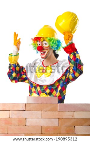 Bad construction concept with clown laying bricks - stock photo