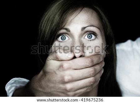 bad guy paining a female - stock photo