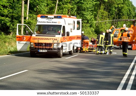 BAD HOMBURG, GERMANY - MAY 5: Helicopter is landing on the street to save and transport a seriously insured person by car accident to hospital, May 05,2007, Bad Homburg, Germany