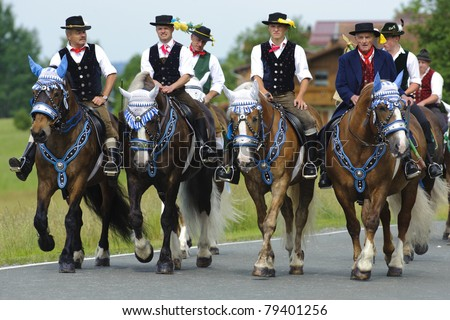 BAD KOETZTING, GERMANY - JUNE 13: 950 rider and horses took part at the biggest german annual and 599th religious horse procession -Pfingstritt- at June 13, 2011 in Bad Koetzting, Germany - stock photo