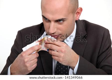 bad man smelling money - stock photo