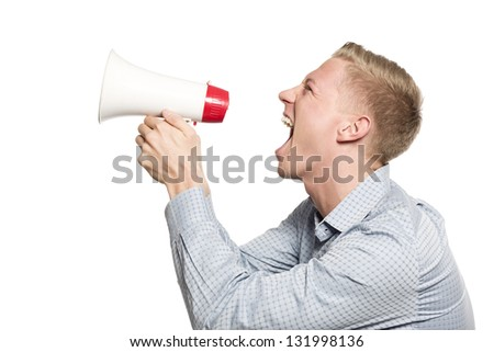 Bad news: Angry businessman shouting with megaphone isolated on white background. - stock photo