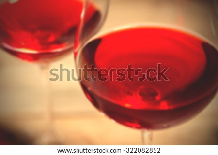 bad red wine in two goblets. romantic blur still life. instagram image filter retro style