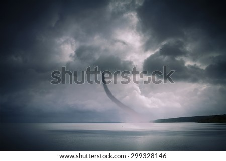 Bad weather and the storm with the wind on the sea. tornado over the ocean - stock photo
