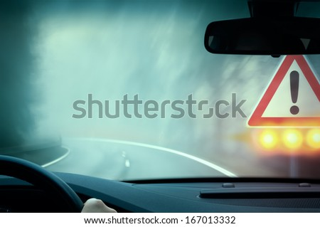 bad weather driving - foggy hazy country road - stock photo