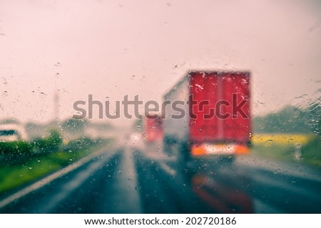Bad weather driving on an expressway - stock photo