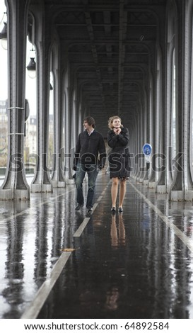 Bad weather in Paris. Couple on the bridge Bir-Hakeim at rainy weather - stock photo
