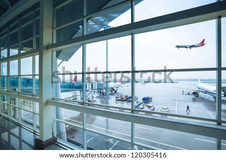 bad weather with airport outside the window scene - stock photo