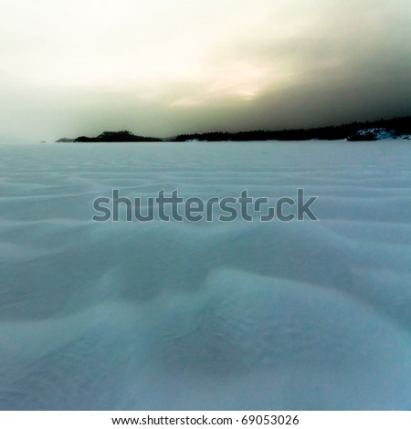 Bad winter weather windswept snowscape of drifting white powder snow. - stock photo