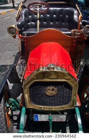BADAJOZ, SPAIN - JULY 4:  Red Le Zebre Typ A, built at year 1908 parked on street July 4, 2010 in Badajoz, Spain - stock photo