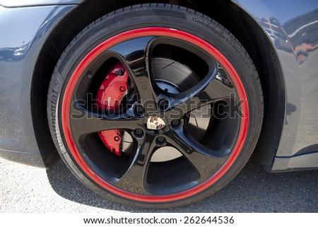 BADAJOZ, SPAIN - MARCH 14, 2015: Ferrari Car show at Badajoz City on Complejo Alcantara resorts, March 14, 2015. Detail image showing the rubber on the Porche Panamera wheel - stock photo
