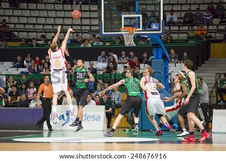 BADALONA, SPAIN - APRIL 13: Michael Roll (8) of Zaragoza in action at Spanish Basketball League match between Joventut and CAI Zaragoza, final score 82-57, on April 13, 2014, in Badalona, Spain. - stock photo