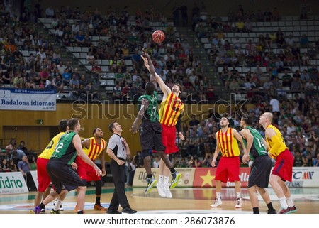 BADALONA, SPAIN - MAY 30: Some players in action at Spanish ACB Basketball League match between Joventut Badalona and FC Barcelona, final score 74-80, on May 30, 2015, in Badalona, Spain. - stock photo