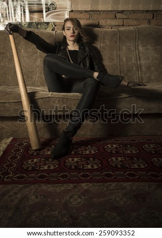 Badass feminist representing a strong and independent woman's behaviour. - stock photo