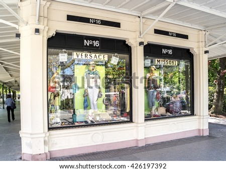 BADEN-BADEN, GERMANY  - MAY 4, 2016 : Versace boutique display window with mannequin in haute couture clothes and luxury accessories for exclusive shopping in the historic center of Baden-Baden.
