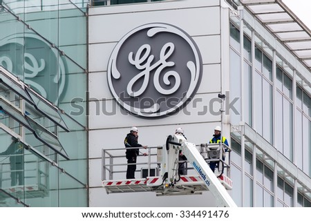 BADEN, SWITZERLAND. November 2nd, 2015. The new General Electric logo has been installed at the former Alstom thermal power headquarters after successful merger and acquisition. - stock photo