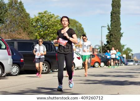 "BADIA DEL VALLES, BARCELONA, SPAIN - APRIL 17, 2016: Unidentified runners in the track during the event of "" La Cursa Badia 10K"", popular race in Badia del Valles village, Barcelona, Spain. - stock photo"