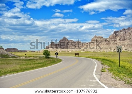 Badlands Loop Road in Badlands National Park in South Dakota, USA. Cloudy Blue Sky - Summer Day. Nature Photo Collection. - stock photo