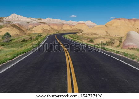 Badlands Loop Road through the Yellow Mounds area of Badlands National Park in South Dakota - stock photo