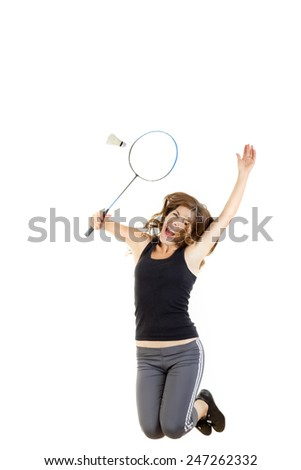 Badminton player in action holding racket to catch shuttlecock on training - stock photo