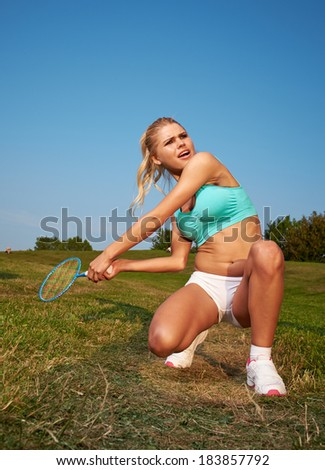badminton player in action . Outdoor sport - stock photo