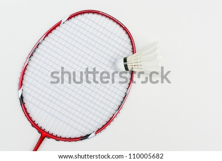 badminton racket in red color with shuttlecock and light blue string in front view angle on white background angle on white background - stock photo