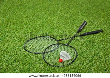 Badminton rackets with white shuttlecock  - stock photo