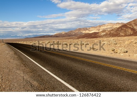 Badwater road in Death valley - stock photo