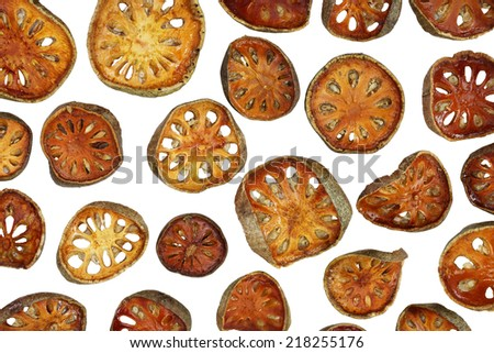 Bael fruit dried isolated on white background - stock photo