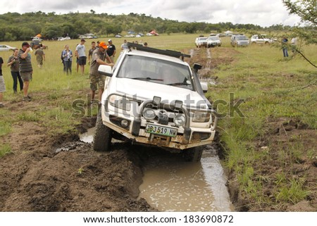 BAFOKENG - MARCH 8: White Mazda BT-50 4x4 3L crossing water obstacle at Leroleng 4x4 track on March 8, 2014 in Bafokeng, Rustenburg, South Africa