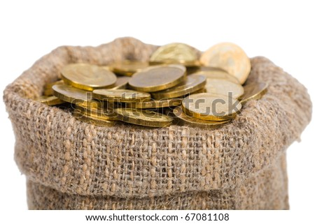 Bag filled with coins. A white background. Isolated. - stock photo