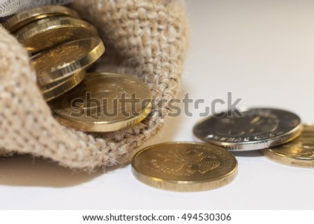 Bag filled with coins, finance concept, business background, money content