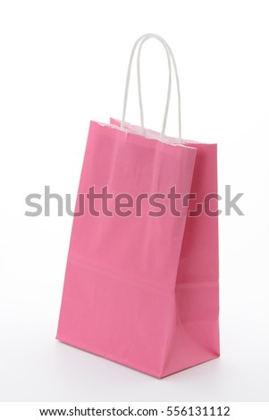 Bag for the purchase of pink paper on white background