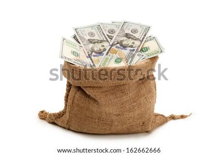 Bag full of cash, the new U.S. 100 dollar bill - stock photo