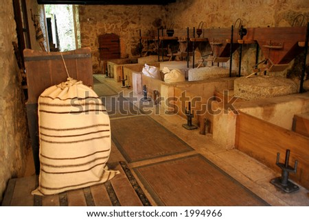 Bag full of flour in old mill - stock photo