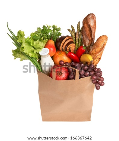 Bag full of healthy food / studio photography of brown grocery bag with fruits, vegetables, bread, bottled beverages - isolated over white background