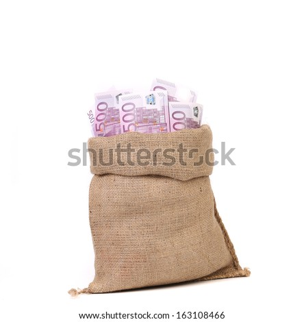 Bag full with of euro bills. Isolated on a white background. - stock photo