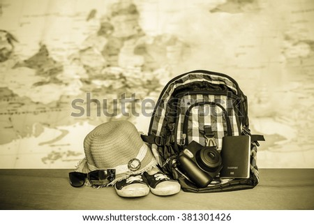 bag,hat and sunglasses with blur map background