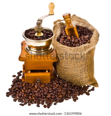 bag of coffee beans and old coffee mill isolated on white background - stock photo