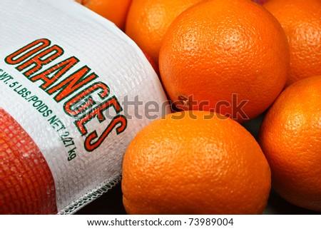 Bag of fresh oranges - stock photo