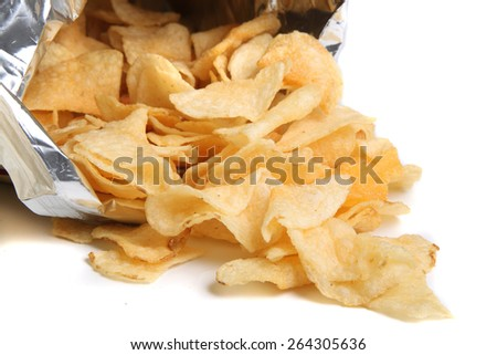 Bag of kettle chips spilling over on a white background - stock photo