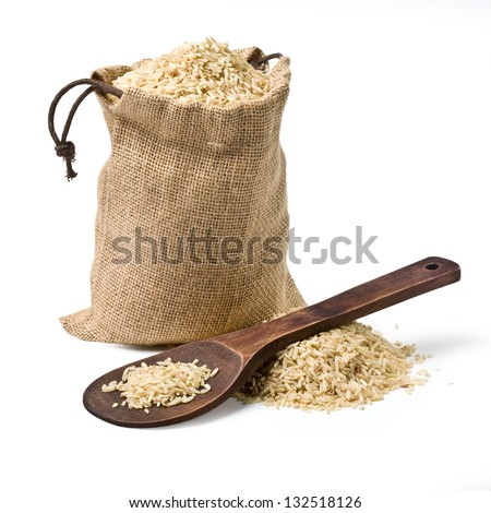 bag of rice and a wooden spoon on a white background. keeping paths - stock photo