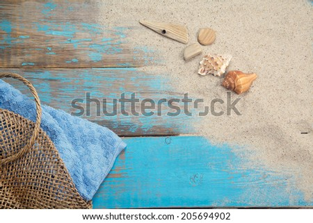 Bag, towel, shell on wooden backgroubd - stock photo